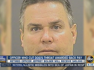 Officer who slit dog's throat granted back pay