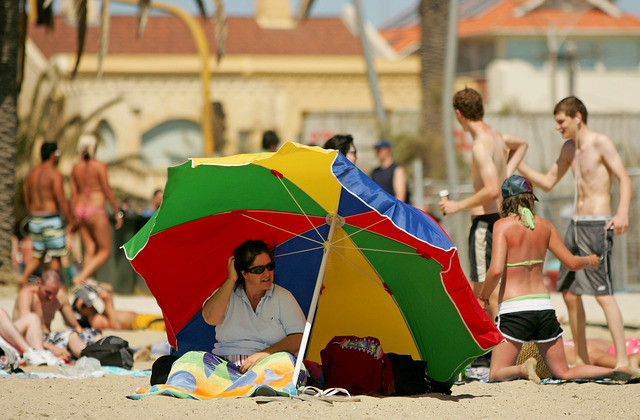 MELBOURNE AUSTRALIA - JANUARY 27 A woman shelters from the sun under an umbrella at St Kilda beach as a heatwave hits Melbourne on January 27 ... & Officials vote to ban tents canopies from Rehoboth Beach ...