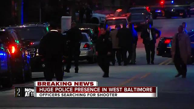 Police continue to search for gunman after Baltimore detective shot