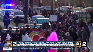 Youth march rallies support for new city fund
