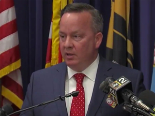 Baltimore waits for reply from FBI in cop murder