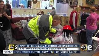 Baltimore Firefighters deliver toys to children