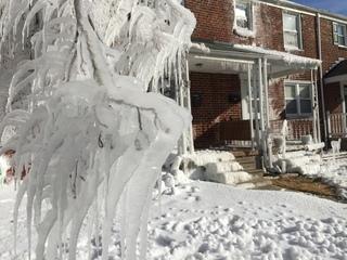 Broken pipe encases Catonsville street in ice