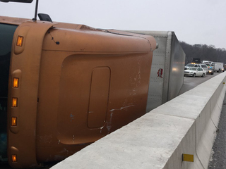 Overturned tractor trailer removed from bridge
