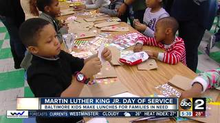 Kids make lunches for families on MLK Day
