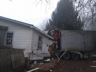 Tractor-trailer drives into Clements home