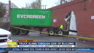 Truck drives through brick wall and into store