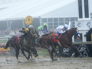 Justify wins Preakness, mud, reverie, and...