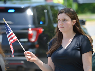 Community comes out for officer's procession
