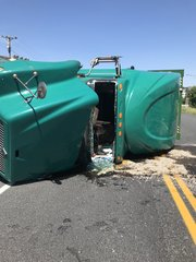 Tractor trailer overturned; driver uninjured