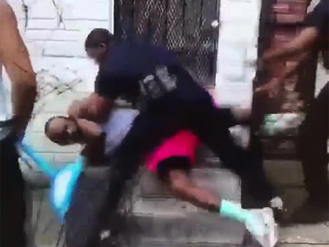 Baltimore officer in viral video charged