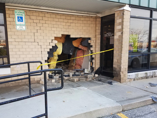 One injured after car drives through post office