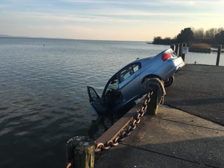 Woman rescued after driving car off pier
